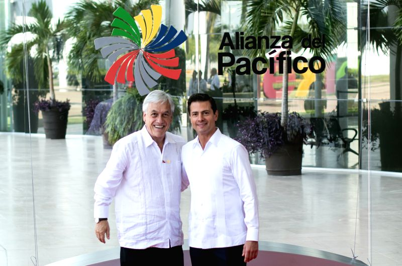 PUERTO VALLARTA, July 25, 2018 - Mexico's President Enrique Pena Nieto (R) and Chile's President Sebastian Pinera pose for photos prior to a meeting during the 13th Pacific Alliance Summit in Puerto ...
