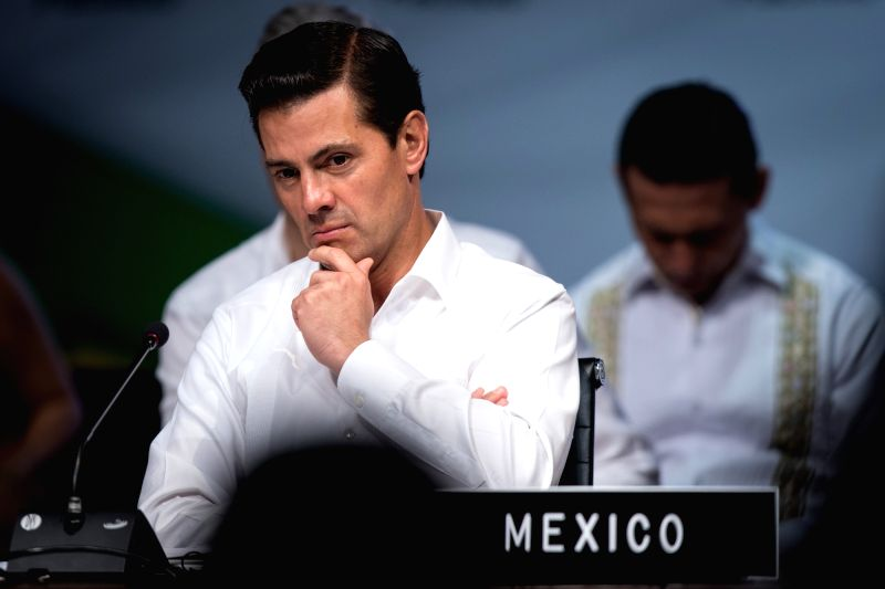 PUERTO VALLARTA, July 25, 2018 - Mexico's President Enrique Pena Nieto attends a meeting during the 13th Pacific Alliance Summit in Puerto Vallarta, Mexico, on July 24, 2018. Latin America's two key ...