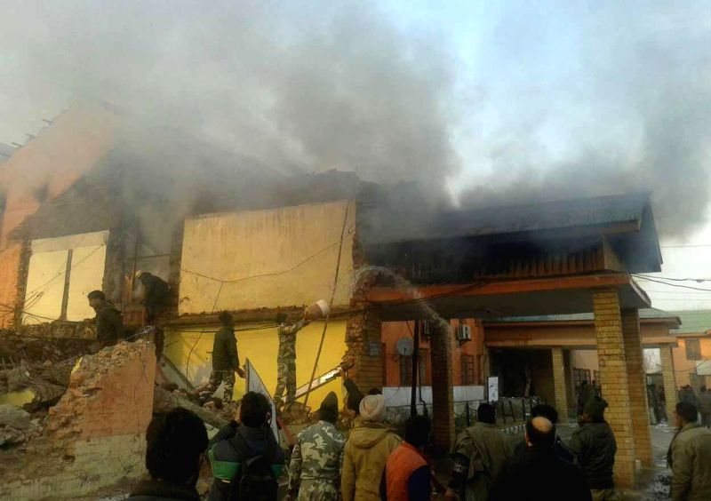 A fire breaks out at the DC office of Pulwama in Jammu and Kashmir, on Dec 29, 2014.
