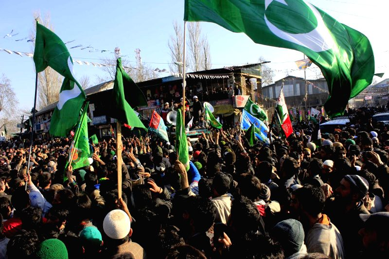 People in large numbers participate in a protest rally against Charlie Hebdo - French satirical weekly magazine for publishing sketches of Prophet Muhammad in Pulwama, on Jan 16, 2015.