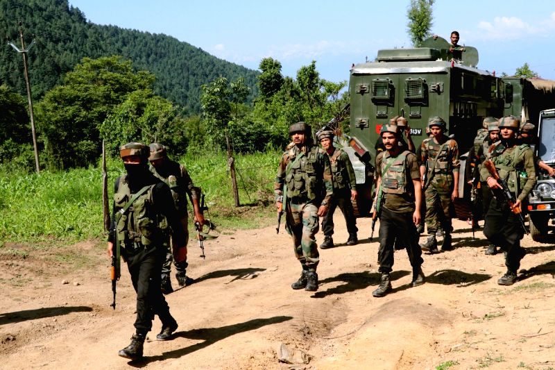 Pulwama: Security forces during a cordon and search operation after a militant was killed in a gunfight in Branpathri forest area of Tral in Jammu and Kashmir's Pulwama district, on June 26, 2019.