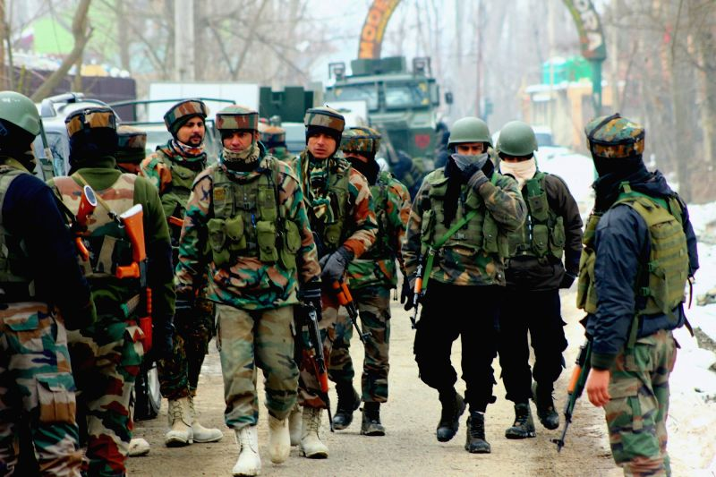 Pulwama: Soldiers during an encounter with militant in Ratnipora village of Jammu and Kashmir's Pulwama district on Feb 12, 2019. Two Indian Army soldiers and a militant were killed in the encounter. (Photo: IANS)