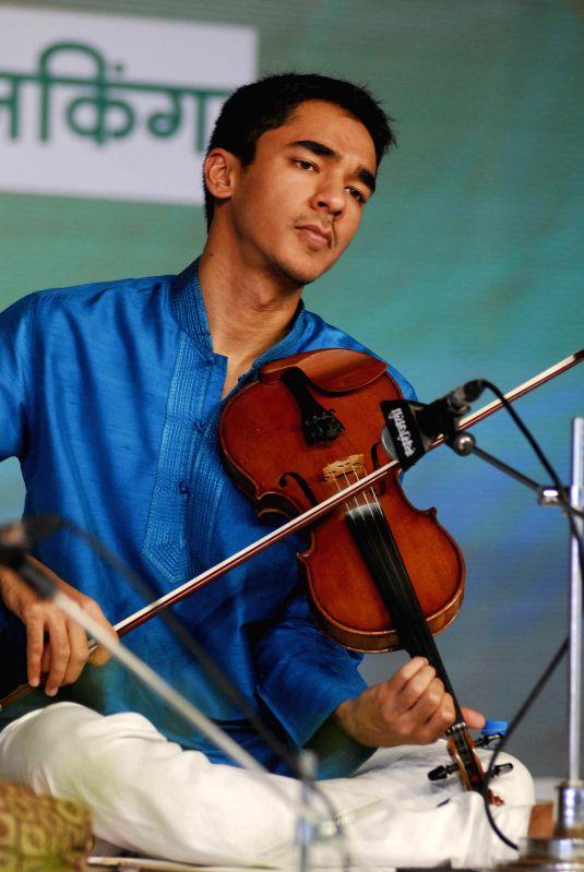Ambi Subramaniam - the son of illustrious violinist Dr. L. Subramaniam and Vocalist Kavita Krishnamurthi - performs at the 62nd Sawai Gandharva Bhimsen Mahotsav in Pune, on Jan 4, 2015.
