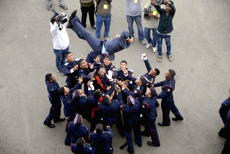 Cadets celebrate during the graduation ceremony at the National Defence Academy in Pune, Maharashtra on Nov. 29, 2014.
