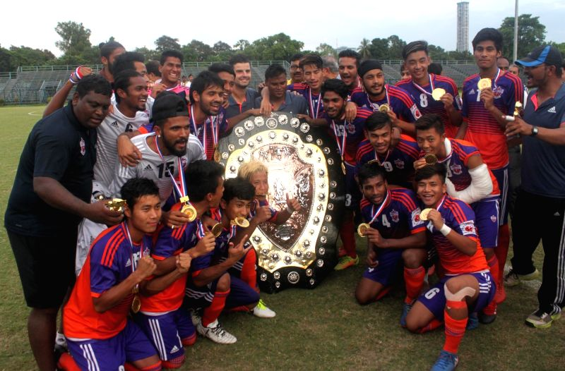 Pune City players celebrate after winning the 121st IFA Shield in Kolkata on June 11, 2017.