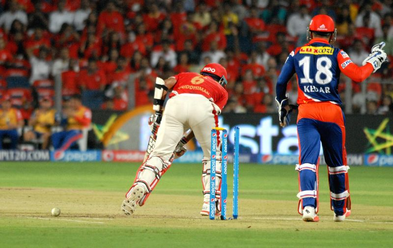 Delhi Daredevils batsmen Wridhiman Saha gets bowled during an IPL-2015 match between Delhi Daredevils and Kings XI Punjab at Maharashtra Cricket Association Stadium, in Pune, on April 15, 2015.