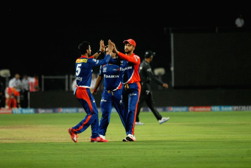 Delhi Daredevils celebrate fall of a wicket during an IPL-2015 match between Delhi Daredevils and Kings XI Punjab at Maharashtra Cricket Association Stadium, in Pune, on April 15, 2015.
