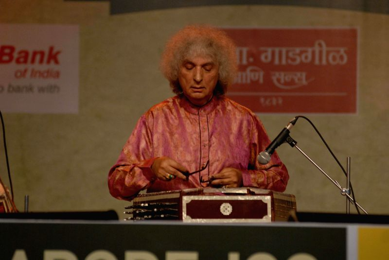 Indian Santoor player Shivkumar Sharma performs during Sawai Gandharva Bhimsen Mahotsav -2014 in Pune on Dec 12, 2014.