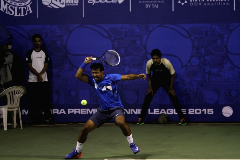 Indian tennis player Leander Paes in action during a PTL exhibition match in Pune on Dec 3, 2014.
