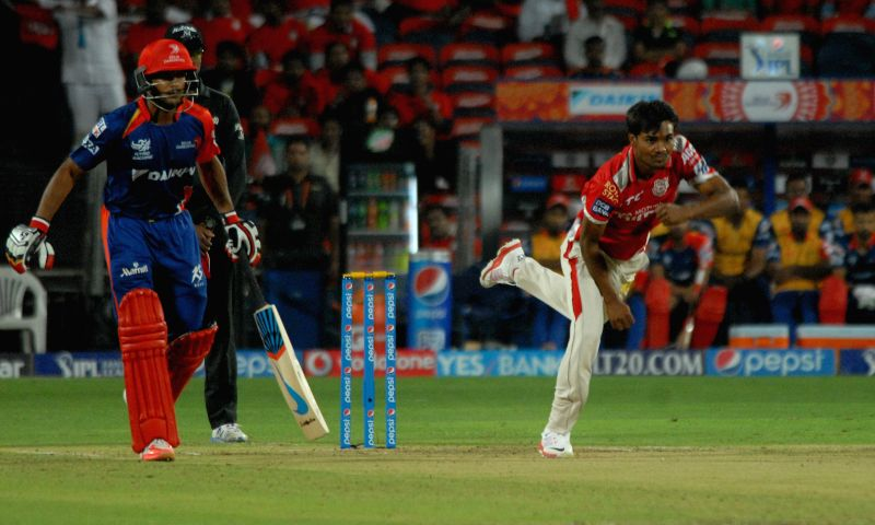 Kings XI Punjab bowler Sandeep Sharma in action during an IPL-2015 match between Delhi Daredevils and Kings XI Punjab at Maharashtra Cricket Association Stadium, in Pune, on April 15, 2015. - Sandeep Sharma