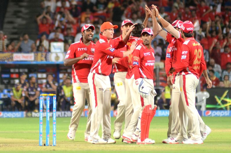 Kings XI Punjab celebrate fall of a wicket during an IPL-2015 match between Kolkata Knight Riders and Kings XI Punjab at Maharashtra Cricket Association Stadium, in Pune, on April 18, 2015.