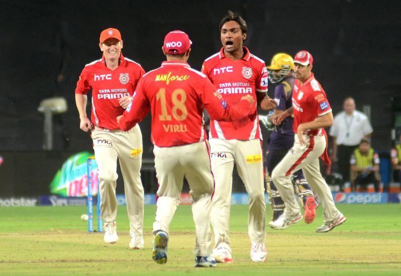 Kings XI Punjab player Sandeep Sharma celebrate fall of a wicket during an IPL-2015 match between Kolkata Knight Riders and Kings XI Punjab at Maharashtra Cricket Association Stadium, in Pune, ... - Sandeep Sharma