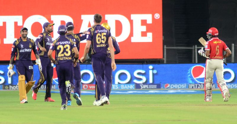 Kolkata Knight Riders celebrate fall of a wicket during an IPL-2015 match between Kolkata Knight Riders and Kings XI Punjab at Maharashtra Cricket Association Stadium, in Pune, on April 18, ...