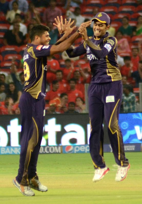 Kolkata Knight Riders player Umesh Yadav celebrate fall of a wicket during an IPL-2015 match between Kolkata Knight Riders and Kings XI Punjab at Maharashtra Cricket Association Stadium, in ... - Umesh Yadav