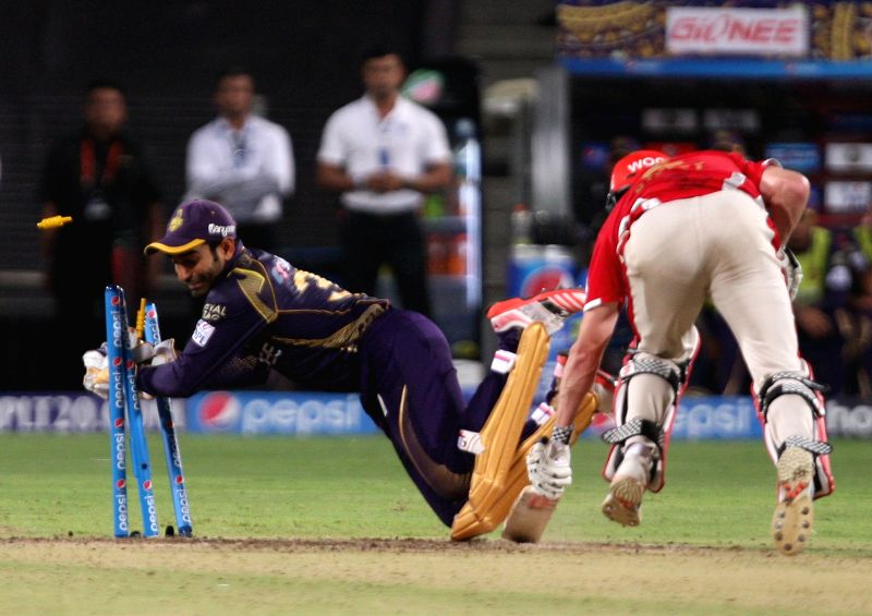 Kolkata Knight Riders wicketkeeper Robin Uthappa dislodge the stumps and completes the run out of George Bailey during an IPL-2015 match between Kolkata Knight Riders and Kings XI Punjab at ...