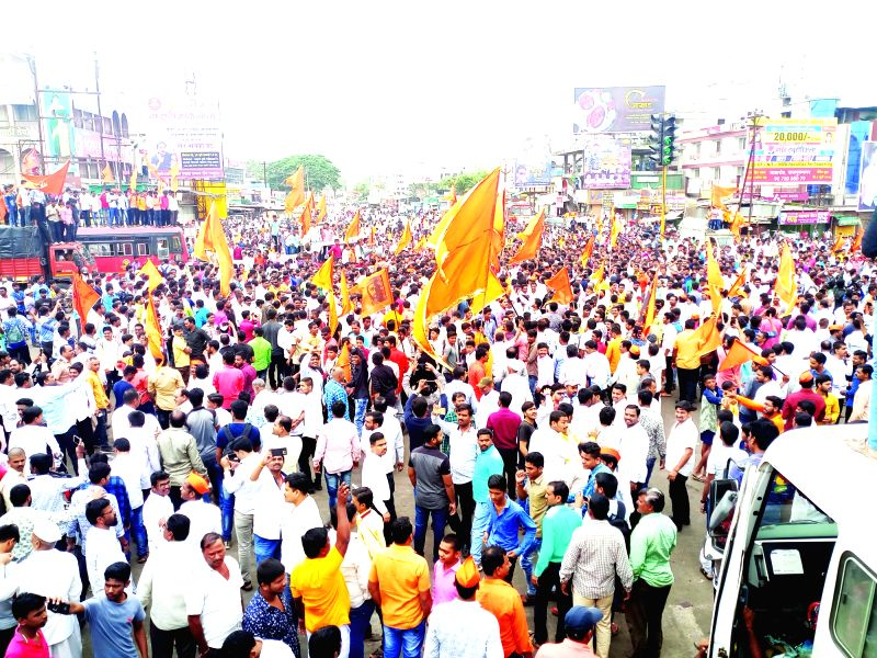 : Pune: Maratha activists staging a demonstration seeking suitable reservations in government jobs and education, block the streets disrupting normal traffic movement; in Pune on July 30, 2018. ...
