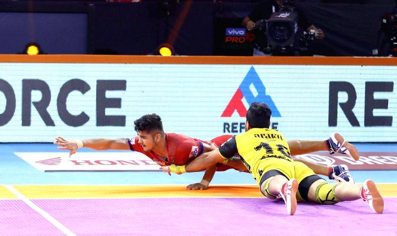 Pune: Players in action during a Pro Kabaddi Season 7 match between Telugu Titans and Dabang Delhi K.C. at Shree Shiv Chhatrapati Sports Complex in Pune on Sep 16, 2019. (Photo: IANS)