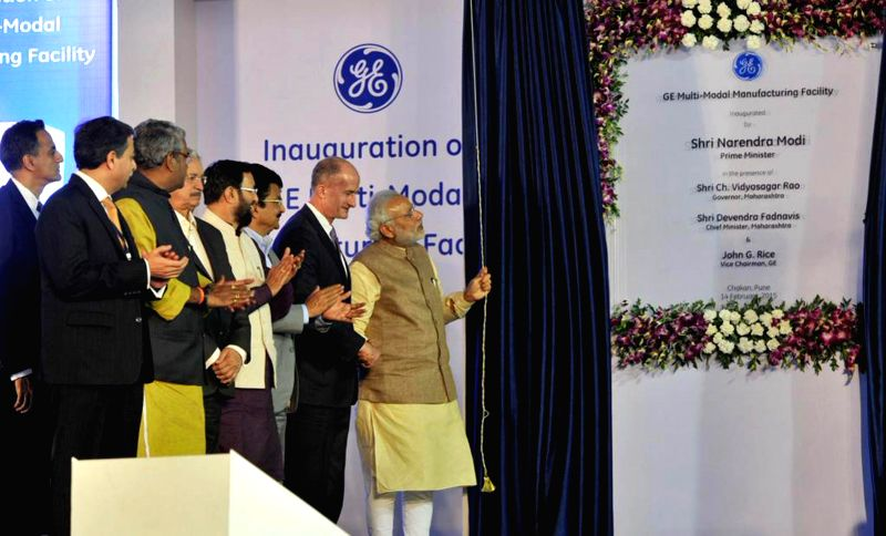 Prime Minister Narendra Modi unveils the plaque to inaugurate the Multimodal Manufacturing Project of GE, at Chakan, in Pune on Feb 14, 2015. Also seen the Maharashtra Governor C. Vidyasagar ... - Narendra Modi and C. Vidyasagar Rao