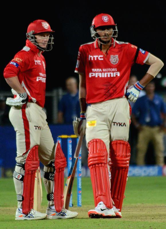 Rajasthan Royals batsmen George Bailey and Axar Patel during an IPL-2015 match between Rajasthan Royals and Kings XI Punjab at Maharashtra Cricket Association Stadium, in Pune, on April 10, ... - Axar Patel