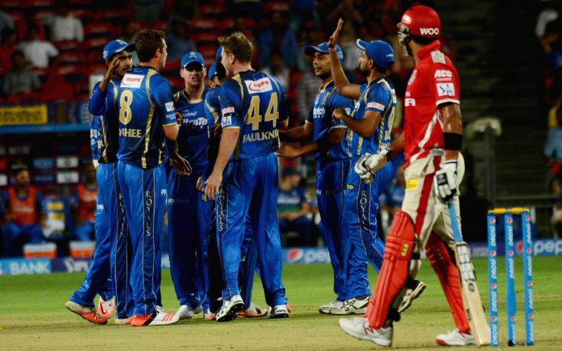 Rajasthan Royals celebrate fall of a wicket during an IPL-2015 match between Rajasthan Royals and Kings XI Punjab at Maharashtra Cricket Association Stadium, in Pune, on April 10, 2015.
