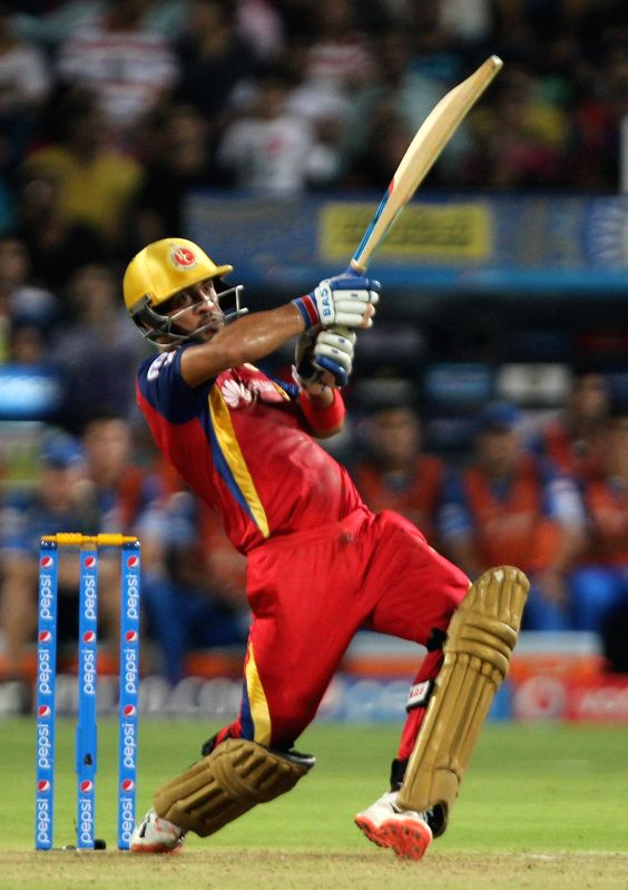 Royal Challengers Bangalore batsman Mandeep Singh in action during the eliminator match of IPL 2015 between Royal Challengers Bangalore and Rajasthan Royals at MCA International Stadium in ... - Mandeep Singh