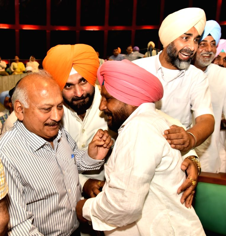 Punjab Cabinet Minister Navjot Singh Sidhu greets Ajaib Singh Bhatti on his elevation as Deputy Speaker of Punjab Assembly in Chandigarh on June 16, 2017. - Navjot Singh Sidhu and Ajaib Singh Bhatti