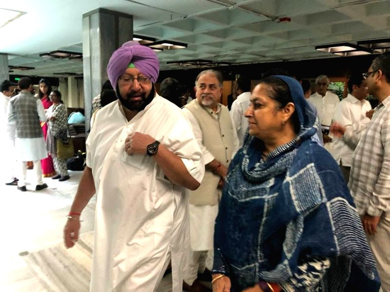 Punjab Chief Minister and Congress leader Amarinder Singh with party leader Asha Kumari arrive to attend the extended Congress Working Committee (CWC) meeting, in New Delhi on July 22, ... - Amarinder Singh