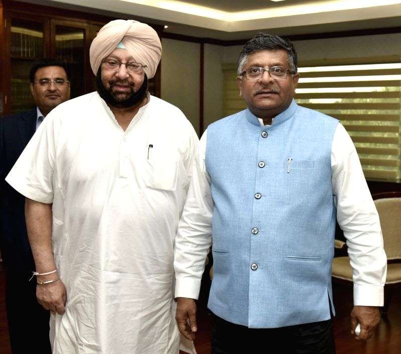 Punjab Chief Minister Captain Amarinder Singh meets the Union Minister for Electronics & Information Technology and Law & Justice Ravi Shankar Prasad in New Delhi on April 20, 2017. - Captain Amarinder Singh