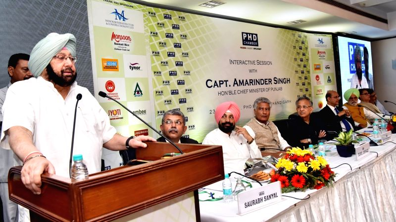 Punjab Chief Minister Captain Amarinder Singh addresses during a programe organsied at PHD Chamber of Commerce and Industry in Chandigarh on May 21, 2017. - Captain Amarinder Singh