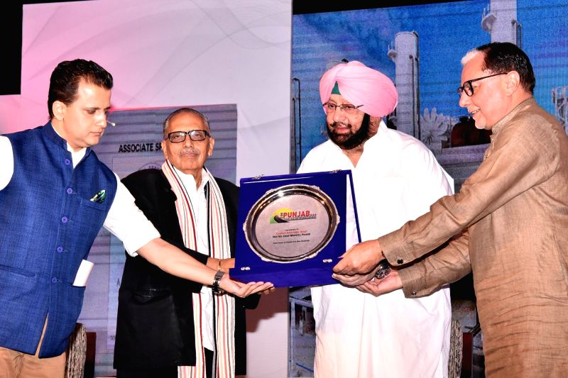 Punjab Chief Minister Captain Amarinder Singh with Essel Group Chairman Subhash Chandra during a television programme in Chandigarh on May 30, 2017. - Captain Amarinder Singh