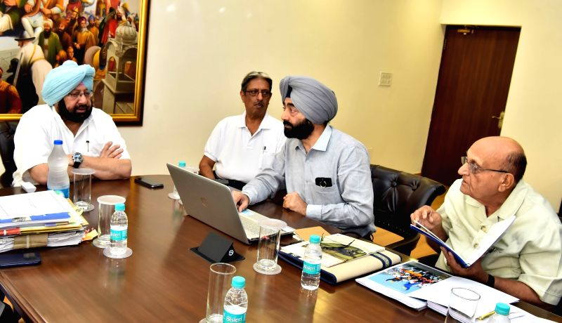 Punjab Chief Minister Captain Amarinder Singh reviews the functioning of Animal Husbandry, Dairy Development and Fisheries department at his official residence in Chandigarh on June 7, ... - Captain Amarinder Singh