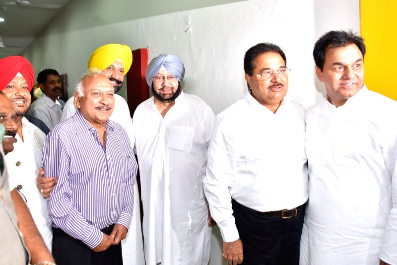 Punjab Chief Minister Captain Amarinder Singh along with state legislators during presidential polls at the state assembly in Chandigarh on July 17, 2017. - Captain Amarinder Singh