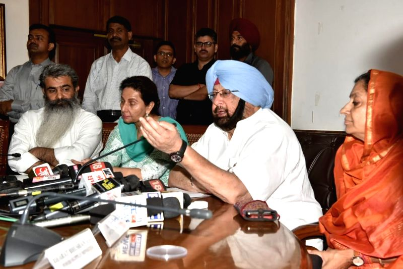 Punjab Chief Minister Captain Amarinder Singh addresses a press conference in Chandigarh on July 30, 2018. - Captain Amarinder Singh