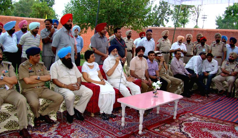 Punjab Chief Minister Parkash Singh Badal addresses the prisoners at  Amritsar Central Security Jail in Amritsar on July 4, 2014. - Parkash Singh Badal