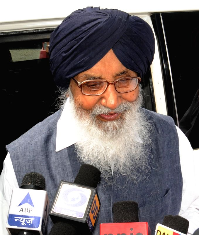 Punjab Chief Minister Parkash Singh Badal interacts with media persons at Sri Guru Ram Das Ji International Airport in Amritsar on Aug 18, 2014. - Parkash Singh Badal