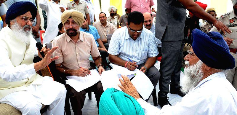 Punjab Chief Minister Parkash Singh Badal interacts with people during a programme in Talwandi Sabo of Punjab's Bathinda district on Aug 31, 2014. - Parkash Singh Badal
