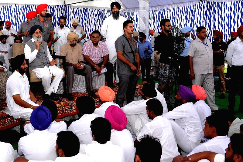 Punjab Chief Minister Parkash Singh Badal interacts with people during a programme in Talwandi Sabo of Punjab's Bathinda district on Sept 1, 2014. - Parkash Singh Badal