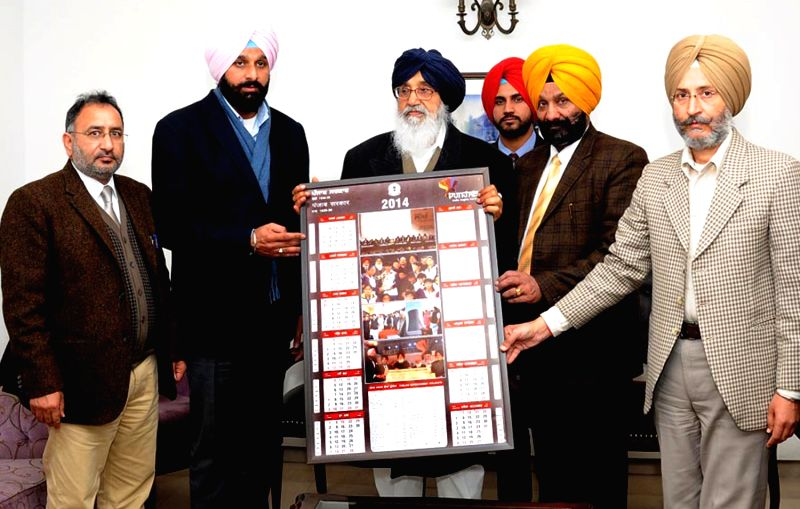 Punjab Chief Minister Parkash Singh Badal and Punjab Revenue Minister Bikram Singh Majithia release official calendar of Punjab Government at Punjab Bhavan in Chandigarh on Jan.3, 2014. - Bikram Singh Majithia