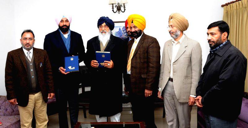 Punjab Chief Minister Parkash Singh Badal and Punjab Revenue Minister Bikram Singh Majithia release official diary of Punjab Government at Punjab Bhavan in Chandigarh on Jan.3, 2014. - Bikram Singh Majithia