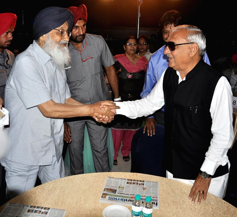 Punjab Chief Minister Parkash Singh Badal and Haryana Chief Minister Bhupinder Singh Hooda during a function in Chandigarh on May 15, 2014. - Bhupinder Singh Hooda