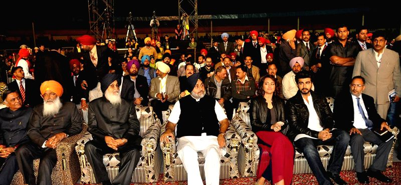 Punjab Chief Minister Parkash Singh Badal and Punjab Deputy Chief Minister Sukhbir Singh Badal interacting with actors Sonakshi Sinha and Arjun Kapoor during the inaugural programme of fifth World ... - Parkash Singh Badal and Sukhbir Singh Badal