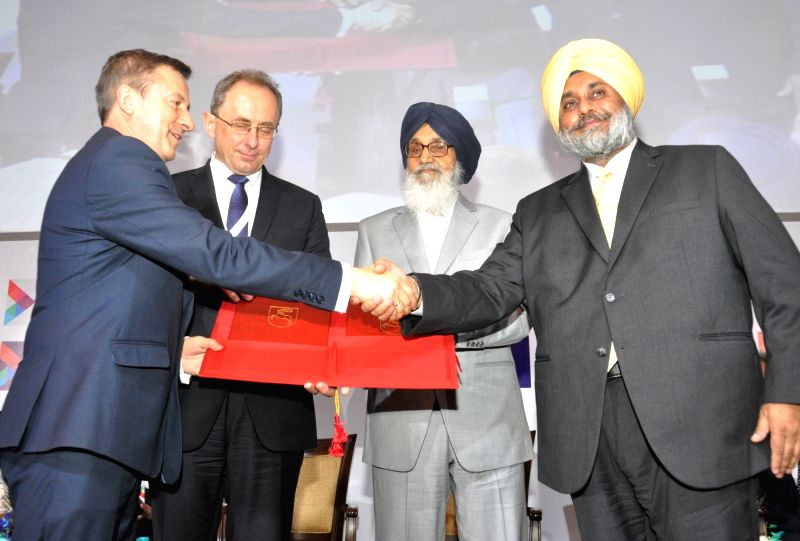 Punjab Chief Minister Parkash Singh Badal and Deputy Chief Minister Sukhbir Singh Badal during Progressive Punjab Summit in Mohali on Oct 28, 2015. - Parkash Singh Badal and Sukhbir Singh Badal