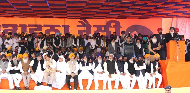 Punjab Chief Minister Parkash Singh Badal and Deputy Chief Minister Sukhbir Singh Badal during a Shiromani Akali Dal rally in Moga of Punjab on Nov 27, 2015. - Parkash Singh Badal and Sukhbir Singh Badal