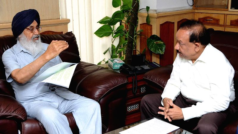 Punjab Chief Minister Parkash Singh Badal during a meeting with Union Health and Family Welfare Minister Harsh Vardhan in New Delhi on June 19, 2014. - Parkash Singh Badal