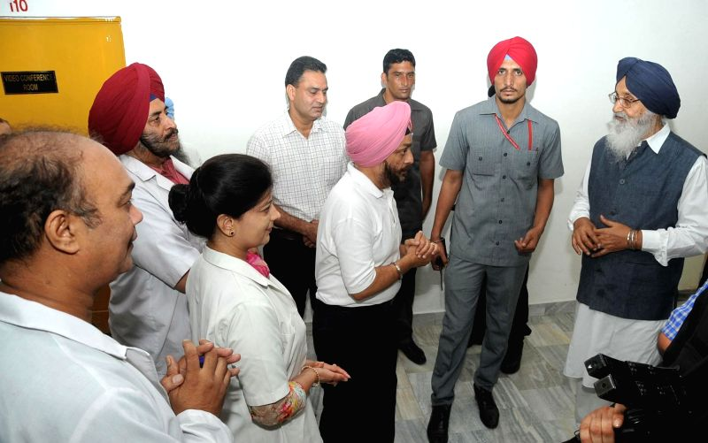 Punjab Chief Minister Parkash Singh Badal during a surprise inspection of Mini Civil Secretariat in Chandigarh on June 30, 2014.