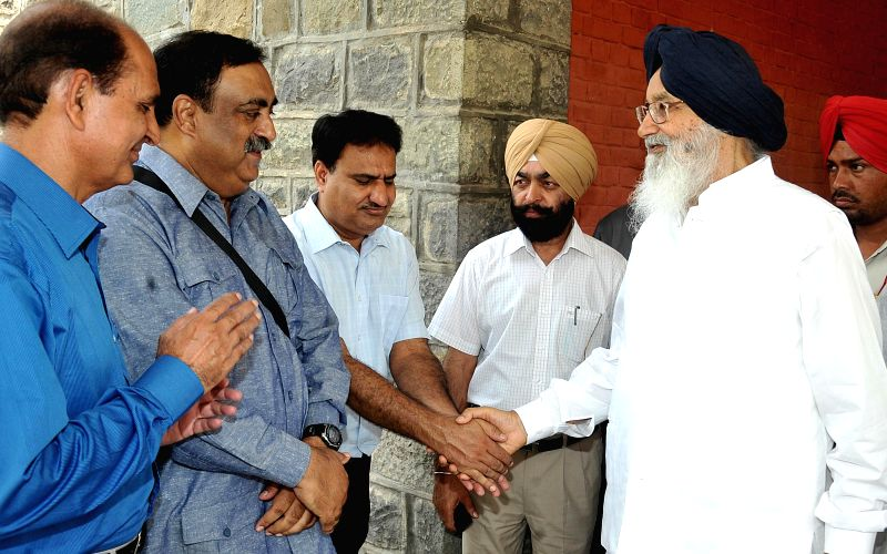 Punjab Chief Minister Parkash Singh Badal during a meeting with the leading Pakistani Sahiwal Cattle Breeder Mohammad Aftab Ahmad Khan Wattoo in Chandigarh on July 11, 2014. - Parkash Singh Badal