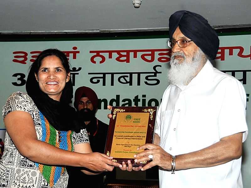 Punjab Chief Minister Parkash Singh Badal during a programme organised to celebrate 33rd foundation day of NABARD in Chandigarh on July 12, 2014. - Parkash Singh Badal