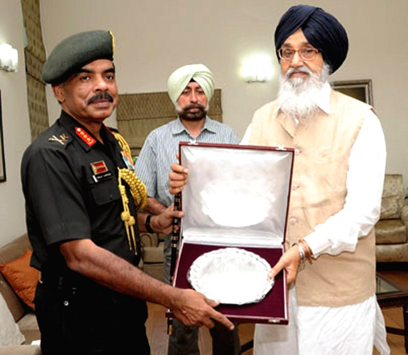 Punjab Chief Minister Parkash Singh Badal during a meeting with General Officer Commanding (GOC) Western Command Lieutenant General Phillip Compose in Chandigarh on July 30, 2014. - Parkash Singh Badal