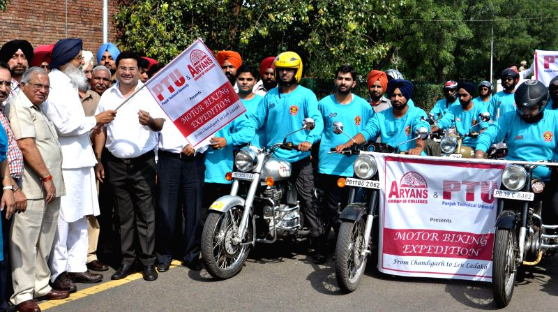 Punjab Chief Minister Parkash Singh Badal flags-off a motorcycle rally to Leh-Ladakh in Chandigarh on June 25, 2014.