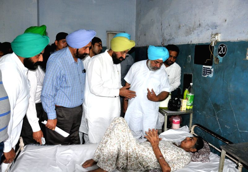 Punjab Congress chief and party's candidate from Gurdaspur Lok Sabha seat, Partap Singh Bajwa meets party workers injured in an attack; at Guru Nanak Hospital in Amritsar on May 4, 2014.